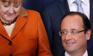 France's President Francois Hollande (R) and Germany's Chancellor Angela Merkel leave after a family photo during a summit at the European Council headquarters in Brussels October 18, 2012
