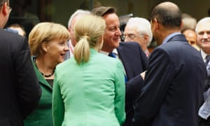 Germany's Chancellor Angela Merkel (L) and Britain's Prime Minister David Cameron (C) chat with other leaders at a European Union leaders summit in Brussels October 19, 2012.