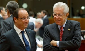Italian Prime Minister Mario Monti, right, speaks with French President Francois Hollande during a round table meeting at an EU summit in Brussels on Friday, Oct. 19, 2012.