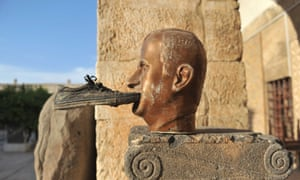 A shoe is seen glued to a statue of late Syrian president Hafez al-Assad, at the museum of Maarat al-Numan, in the northwestern Idlib province, on October 17, 2012.