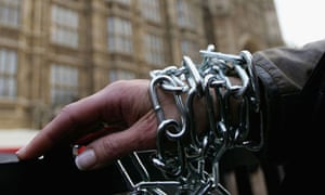 Protester chained to railings outside parliament