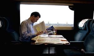 George Osborne travels on a train