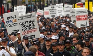 Off-duty police officers march in protest at funding cuts through central London May 10 2012.