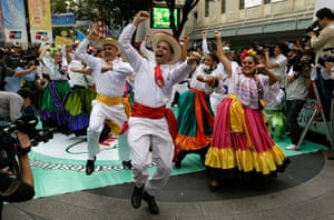 Gangnam style parade: Participants from Costa Rica perform