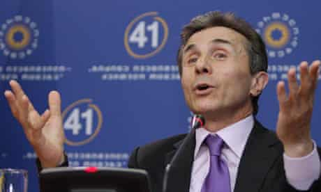 Georgian presidential candidate Ivanishvili speaks during a news conference at his office in Tbilisi