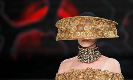 A model wears a Sarah Burton outfit
