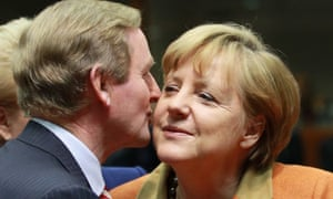 Prime Minister of Ireland Enda Kenny (L) and German Chancellor Angela Merkel greet each other at the start of the EU Summit at EU council headquarters in Brussels, Belgium, 18 October 2012.