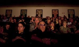 People at the Andy Williams memorial service at the Moon River theatre, in Branson, Missouri, watch the singer's friends and family speak on Sunday 21 October.  Williams, known for his performance of Moon River and his Christmas television specials, died on 25 September