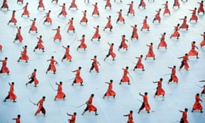 Students from a martial arts school perform during the opening ceremony of the Ninth Shaolin international martial arts festival in Zhengzhou, Henan province, China