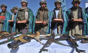 Former Taliban fighters display their weapons after they joined Afghan government forces during a ceremony in Herat.