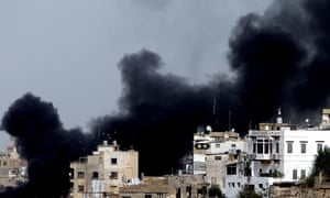 Black smoke billows over Tripoli's Bab al Tabanneh neighbourhood during clashes with Alawites, an offshoot of Shia Islam, in the Jabal Mohsen area in northern Lebanon