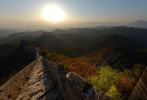 Autumn colours: The sun sets over the Great Wall of China at Jinshanling, Hebei Province