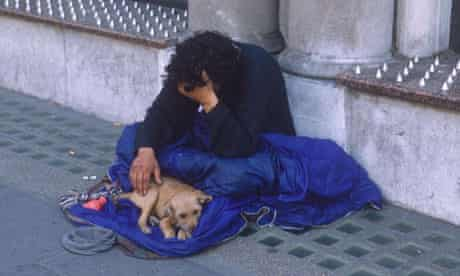 Homeless man with dog in London