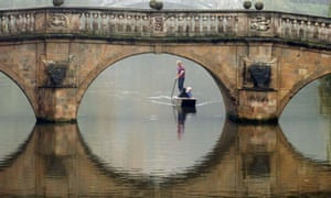 Fog lingers in southern England as a punt makes its way along the river Cam in Cambridge