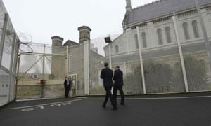 David Cameron is escorted by prison governor Phil Taylor, right, during his visit to Wormwood Scrubs prison in west London