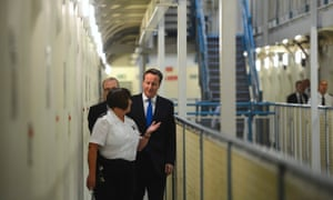And here he is inside with prison officer Margaret Vaughan in C wing.