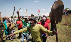 Some of the thousands of striking Harmony Gold workers hold a mass meeting on top of a hill near Carltonville, South Africa. Harmony Gold miners have been on strike for one month over wages.