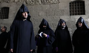 Armenian clergymen attend the funeral procession of the 96th Armenian patriarch of Jerusalem, Torkom Manougian II, at St James Cathedral in Jerusalem's old city. Manougian, who passed away on 12 October at the age of 93, was buried in a funeral attended by representatives of all the Christian churches of the Holy Land