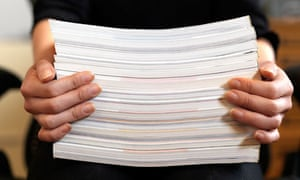 Female hands holding stack of papers