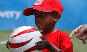 Six-year-old Ofentse Siphiri, who attends Johannesburg School for the Blind, takes part in a soccer clinic in Johannesburg, Monday. The clinic is led by German former Liverpool soccer player Dietmar Hamann and four Liverpool coaches.