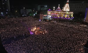 Indian devotees hold earthen lamps as they take part in the Maha Aarti ritual at Hindu deity Umiya Mata temple on the eighth night of Navratri or nine nights festival in Surat, Gujarat state, India. Every year thousands of devotees participate in this ritual.
