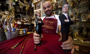 Punch and Judy Italian style: Naples artist Genny Di Virgilio (C) poses with figurines of US President Barack Obama and Republican presidential candidate Mitt Romney (R) in Naples, Italy. Di Virgilio is located in Naples' Via San Gregorio Armeno, a street famous for its shops selling hand crafted nativity scenes and all kind of painted figurines and statuettes.