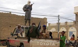 Ansar Dine fighters stand guard in Timbuktu, Mali