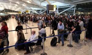 Foggy travel: Passengers queue to be rebooked onto flights in Terminal 5 of Heathrow Airport as fog causes delays to the inbound and outbound aircraft. London City Airport experienced delays while there were 30-minute hold-ups for both incoming and departing flights at Heathrow in west London.