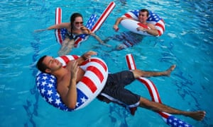 Happy floaters: Matt Alleva (front) along with other students play in the campus pool prior to the debate between U.S. President Barack Obama and Republican presidential candidate Mitt Romney at Lynn University in Boca Raton, Florida. The focus for the final presidential debate before Election Day on November 6 is foreign policy.