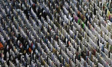 Muslim pilgrims pray outside the Grand mosque in Mecca, Saudi Arabia. The annual Islamic pilgrimage draws three million visitors each year, making it the largest yearly gathering of people in the world.