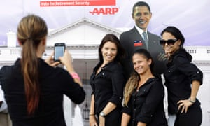 Photo opportunity: Workers pose for a photo with a life-sized cutout of President Barack Obama at a presidential debate fair on the campus of Lynn University in Boca Raton, Fla., where President Barack Obama and Republican presidential candidate and former Massachusetts Gov. Mitt Romney will hold their final debate. Photograph: Eric Gay/AP