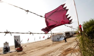 A Qatari flag at a residential project in Gaza