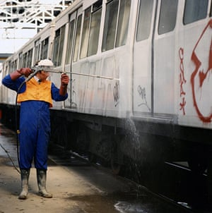 Underground book: Graffiti being removed from a train