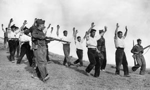 Republican soldiers surrender to Franco's troops in 1936