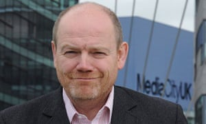 File photo of BBC Director General Thompson posing for media on a visit to Media City in Salford