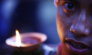 A Nepalese Hindu devotee with a burning oil lamp as part of a ritual to celebrate the tenth and final day of Dashain festival at Bhaktapur, also known as the city of devotees, on the outskirts of Katmandu.