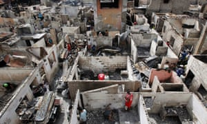 Filipinos return to burned houses a day after a fire in Sangandaan district of Quezon City, east of Manila, the Philippines. City social welfare workers estimated that more than 300 families were affected by the fire.