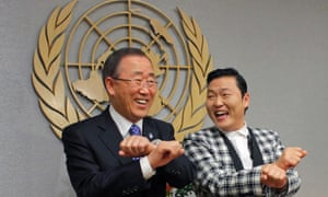 """South Korean singer Psy practises some """"Gangnam Style"""" dance steps with U.N. Secretary-General Ban Ki-moon during a photo opportunity at the U.N. headquarters in New York."""