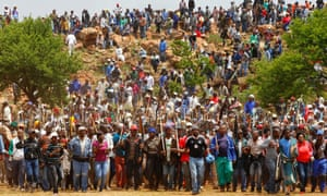 Striking miners chant slogans as they gather at the AngloGold Ashanti mine in Carletonville, northwest of Johannesburg. AngloGold Ashanti said it will fire about 12,000 strikers after they ignored a deadline to return to work by noon.