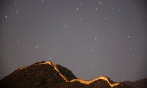 Stars seen above a section of the Great Wall of China illuminated by moonlight near the village Xiang Shui Hu.