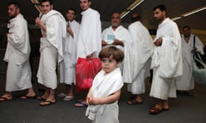 A child of a Syrian refugee going to Mecca for the haj pilgrimage at Beirut international airport. The refugees' pilgrimage is being funded by the Saudi government.