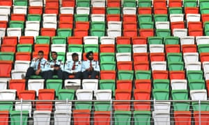 Indian private security guards sit on spectator seats at the Buddh international circuit in Noida, on the outskirts of New Delhi, India. The second Indian Formula One Grand Prix is scheduled for October 26-28.