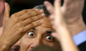 The eyes have it: Barack Obama greets supporters after speaking at a campaign stop at The Mississippi Valley Fairgrounds, in Davenport, Iowa.
