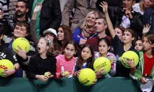 Tennis fans wait for autographs following the match between Li Na of China and Serena Williams of the USA at the round-robin stage of the WTA Championships tennis tournament in Istanbul, Turkey.
