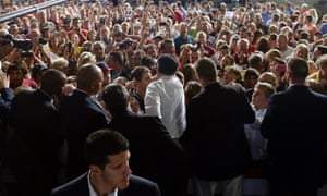 A big crowd greets Mitt Romney as he campaigns at Landmark Aviation at The Eastern Iowa Airport in Cedar Rapids, Iowa, Wednesday evening.