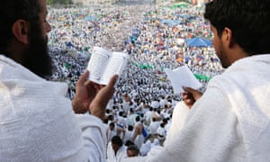 Muslim pilgrims pray on a rocky hill called the Mountain of Mercy, on the Plain of Arafat near the holy city of Mecca, Saudi Arabia. Saudi authorities say around 3.4 million pilgrims have arrived in the holy cities of Mecca and Medina.