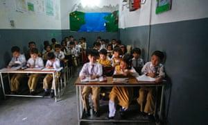 Hazara schoolchildren in a class at Ummat public school in Mehrabad, Quetta. The Hazaras are almost all members of Pakistan's Shi'ite minority.