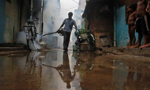 worker fumigates against dengue in Chennai,  India