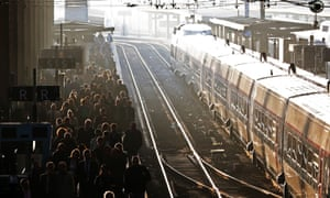 Commuters make their way along a train platform after they arrived on a suburban train at the Gare de Lyon station in Paris during a strike by French SNCF railway employees.