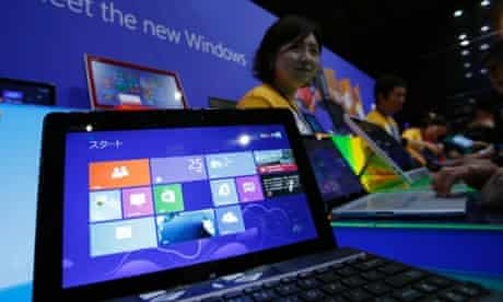 People try out Microsoft Corp's Windows 8 operating system at an event for its debut at the Akihabara electronics store district in Tokyo